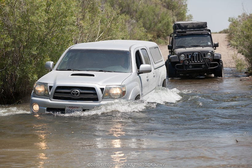 One of our clients in his Toyota Tacoma closely followed by Steve in his jeep JK, crossing a swollen river during a Bodie/Mono adventure.